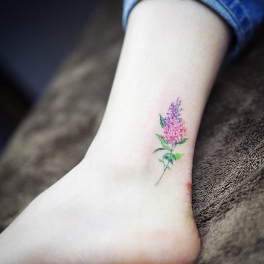 personas cursis flower tattoo