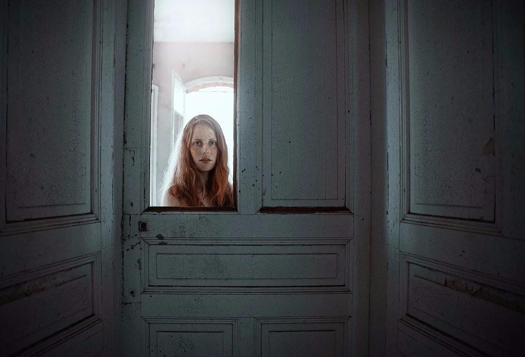 sad girl photography door