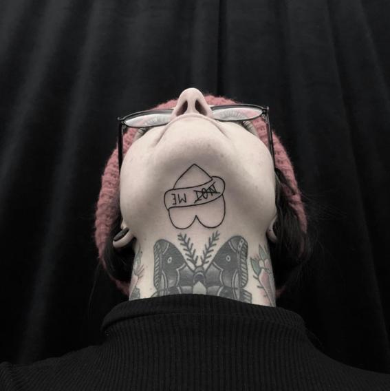 under chin tattoo trend 2