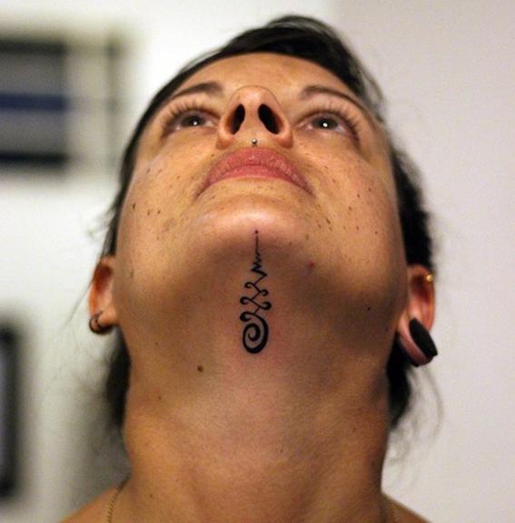 under chin tattoo trend 1
