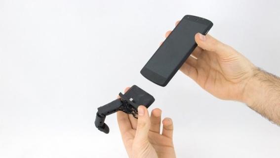 mobilimb dedo robotico que acaricia tu mano mientras usas celular 1