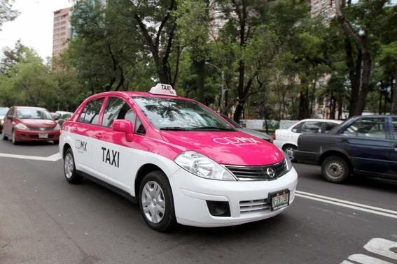 taxistas exigen app y circular en contingencia ambiental 2
