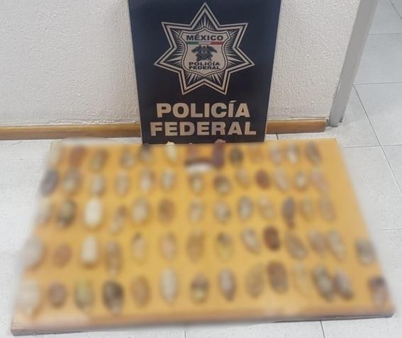 encuentran 67 paquetes de cocaina en el drenaje del aicm 1