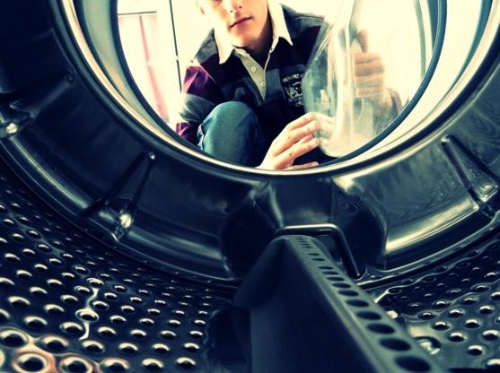 nino atrapado lavadora 1