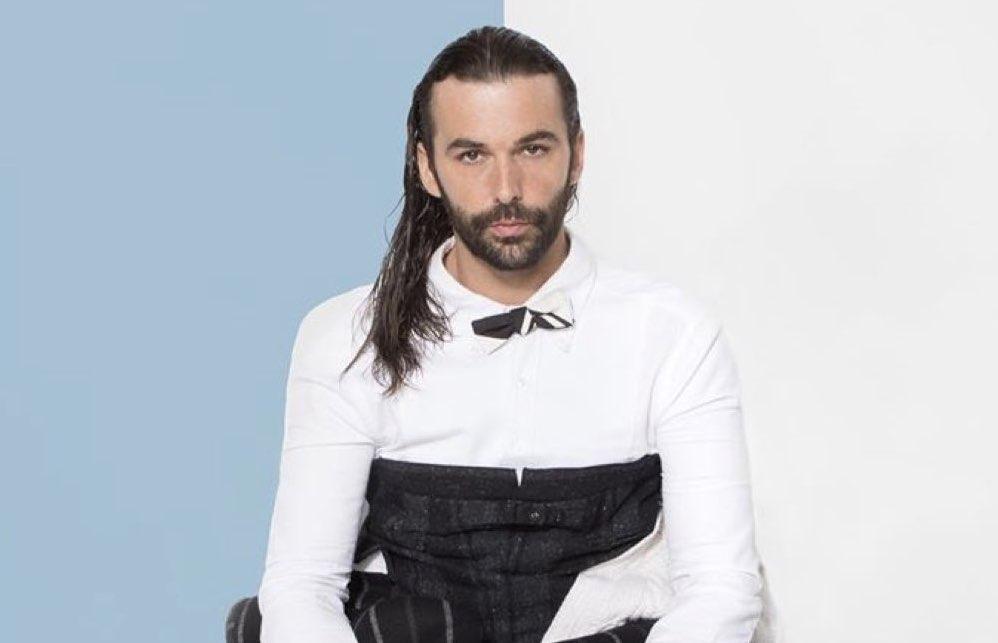 queer eye star jonathan van ness in white shirt and black corset
