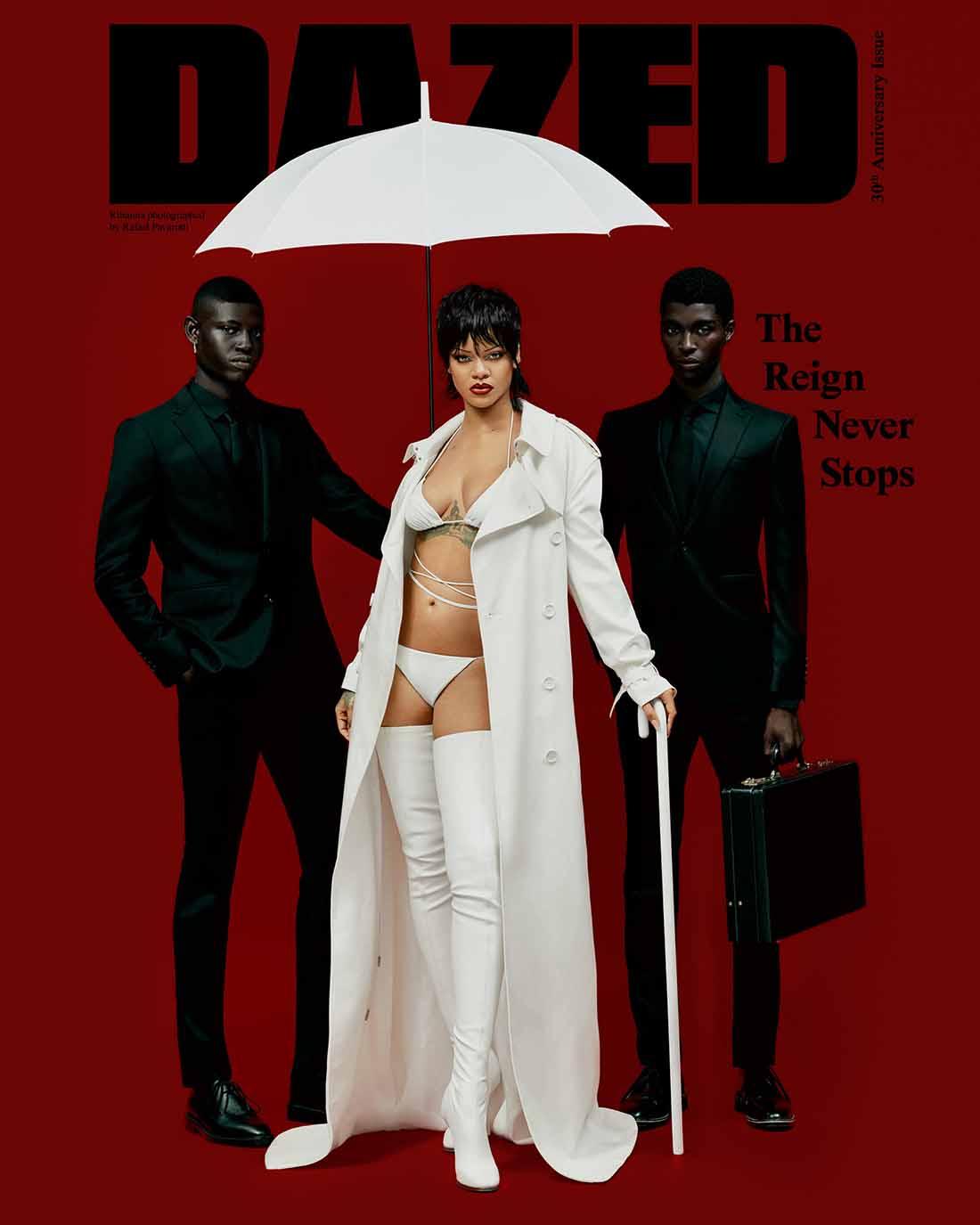 Poster de Rihanna vestida de blanco junto a dos hombres vestidos de negro